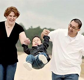 parents-swinging-son
