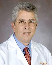 John B. Holcomb MD