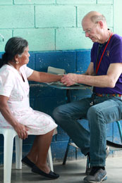 Dr. Johnson examines a patient in a Guatemalan village.