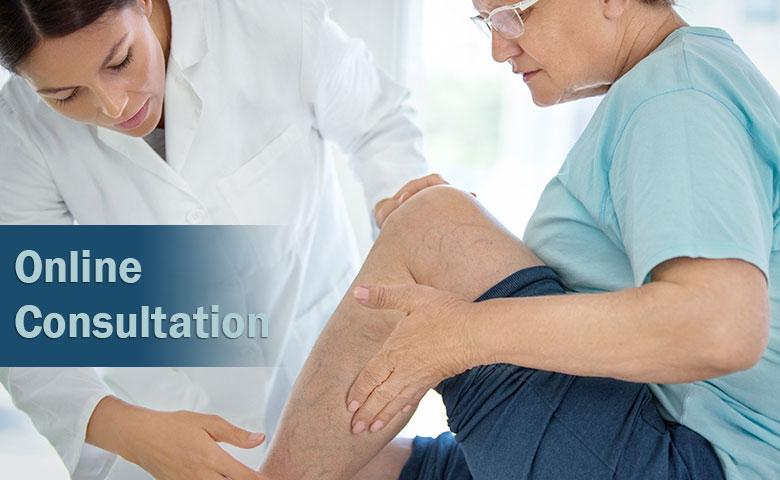 Provider examines patient's leg.