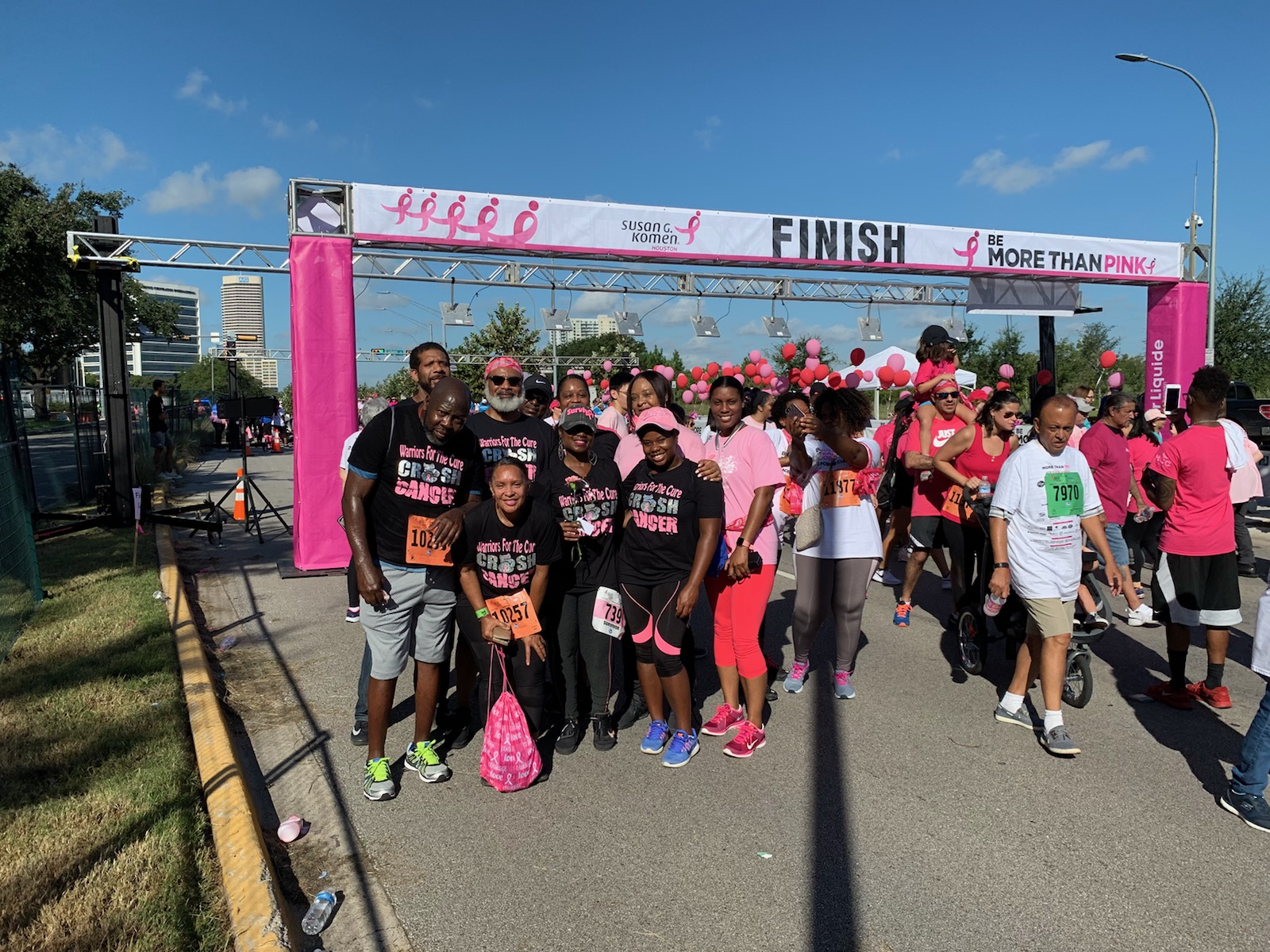 Carla Square celebrating another completed race to raise awareness and research dollars for breast cancer.