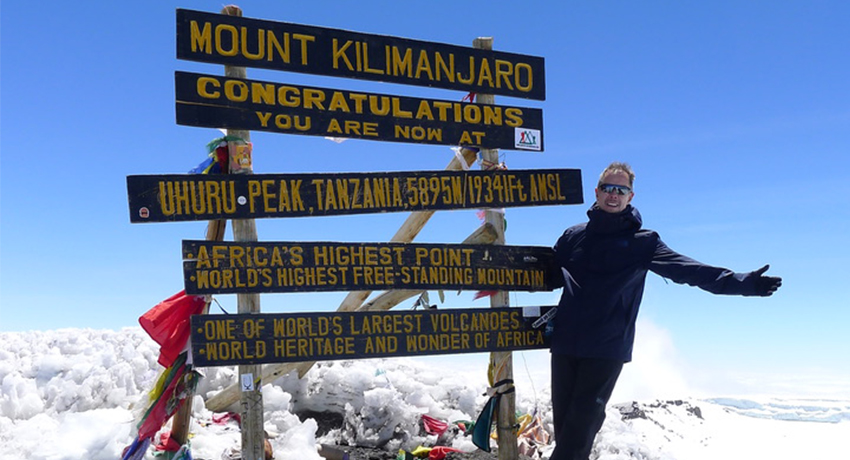 Steve Dome poses for a picture on Mt. Kilimanjaro in August 2018.