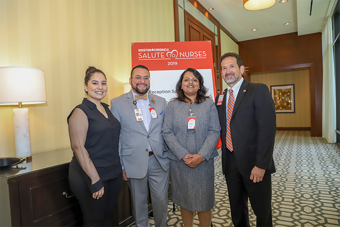 From left to right: Thelma Rios, LVN, with Omar Sandoval, BSN, RN, Ribi Kurian, RN and Andrew Casas, COO of UT Physicians.