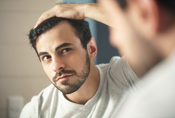 Man Worried with Hair Loss