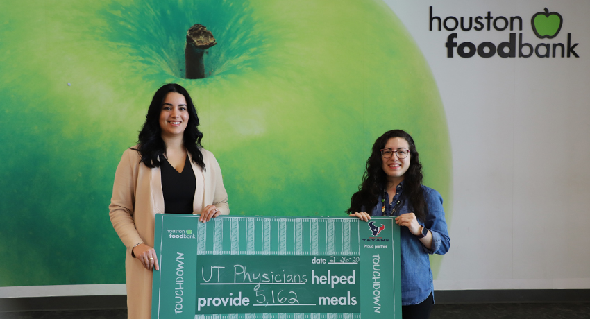Sahar Qashqai, executive director of Healthcare Transformation Initiatives, delivers donation to the Houston Food Bank on behalf of UT Physicians.
