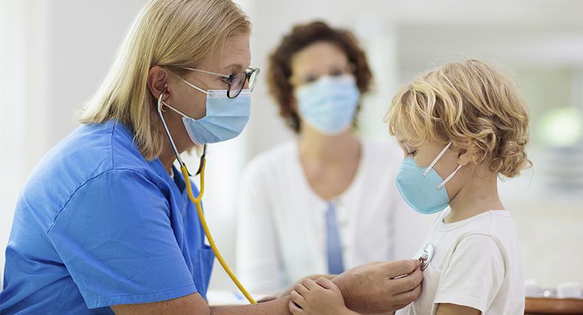 Pediatrician with patient providing immunizations