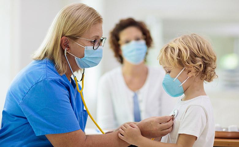 Masked Doctor Examining Child