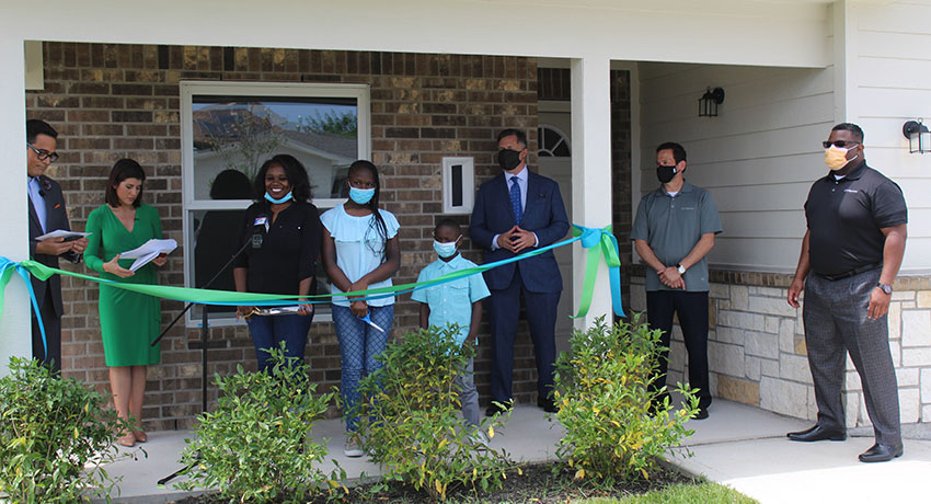 ribbon-cutting for new home