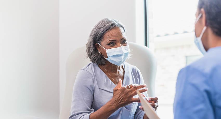 Senior patient speaking with doctor