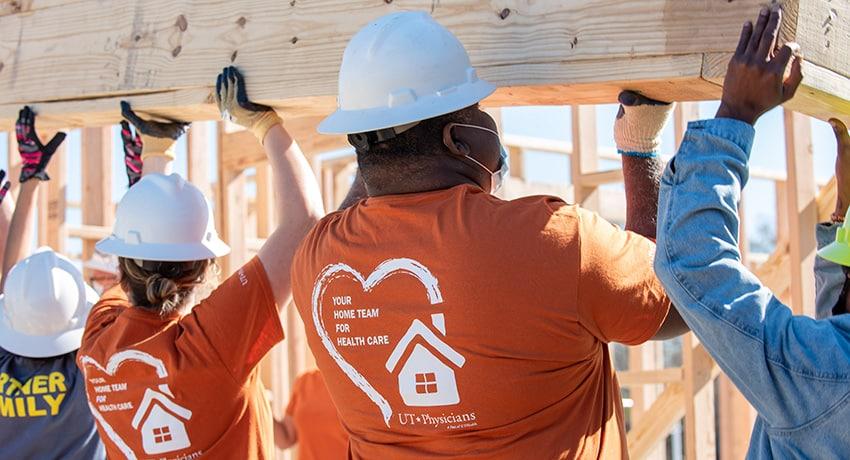 UT Physicians/UTHealth employees on Habitat build site