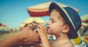 Child drinking water and staying hydrated