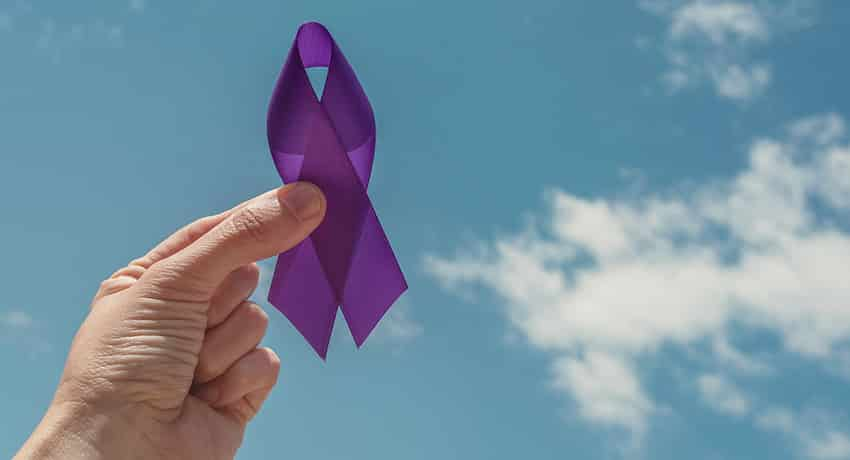 Purple ribbon to note Pancreatic Cancer Awarness