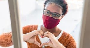 Woman in red mask in support of National Wear Red Day