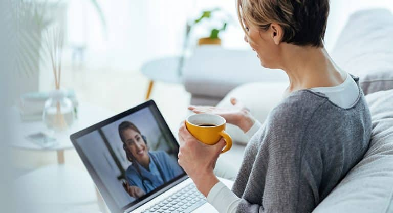 woman on telehealth call with provider