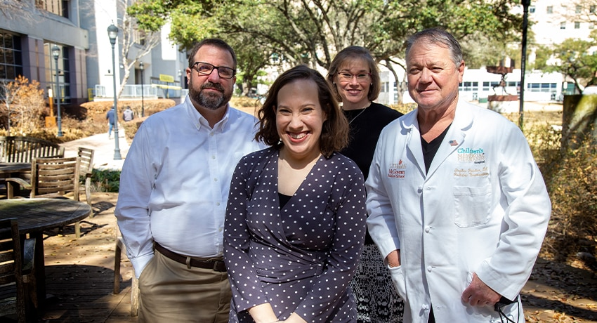 Alexis Shelly and her parents with Stephen Fletcher, DO. (Photo by Cody Duty/UTHealth)