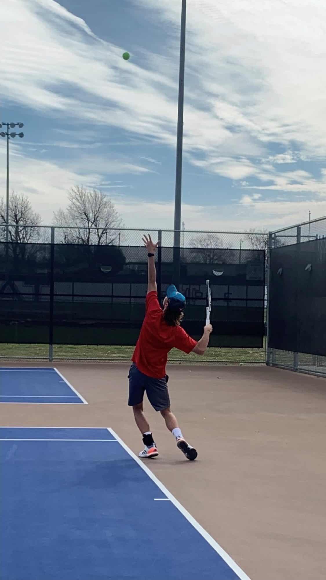 Luke Henley on the tennis court
