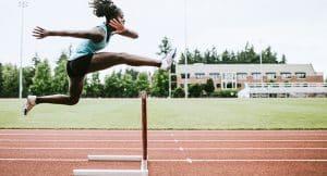 student athlete running track