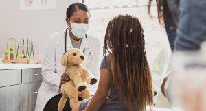 children's doctor interacting with patient